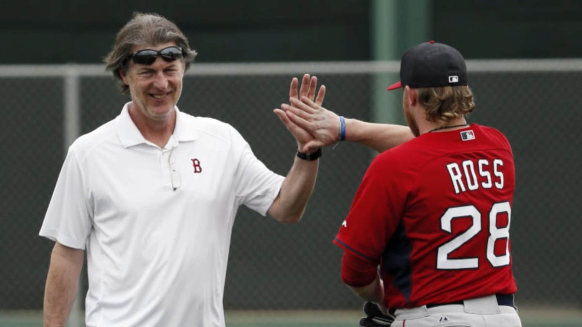 Boston Red Sox mental skills coach Bob Tewksbury, left, greets starting pitcher Robbie Ross Jr.