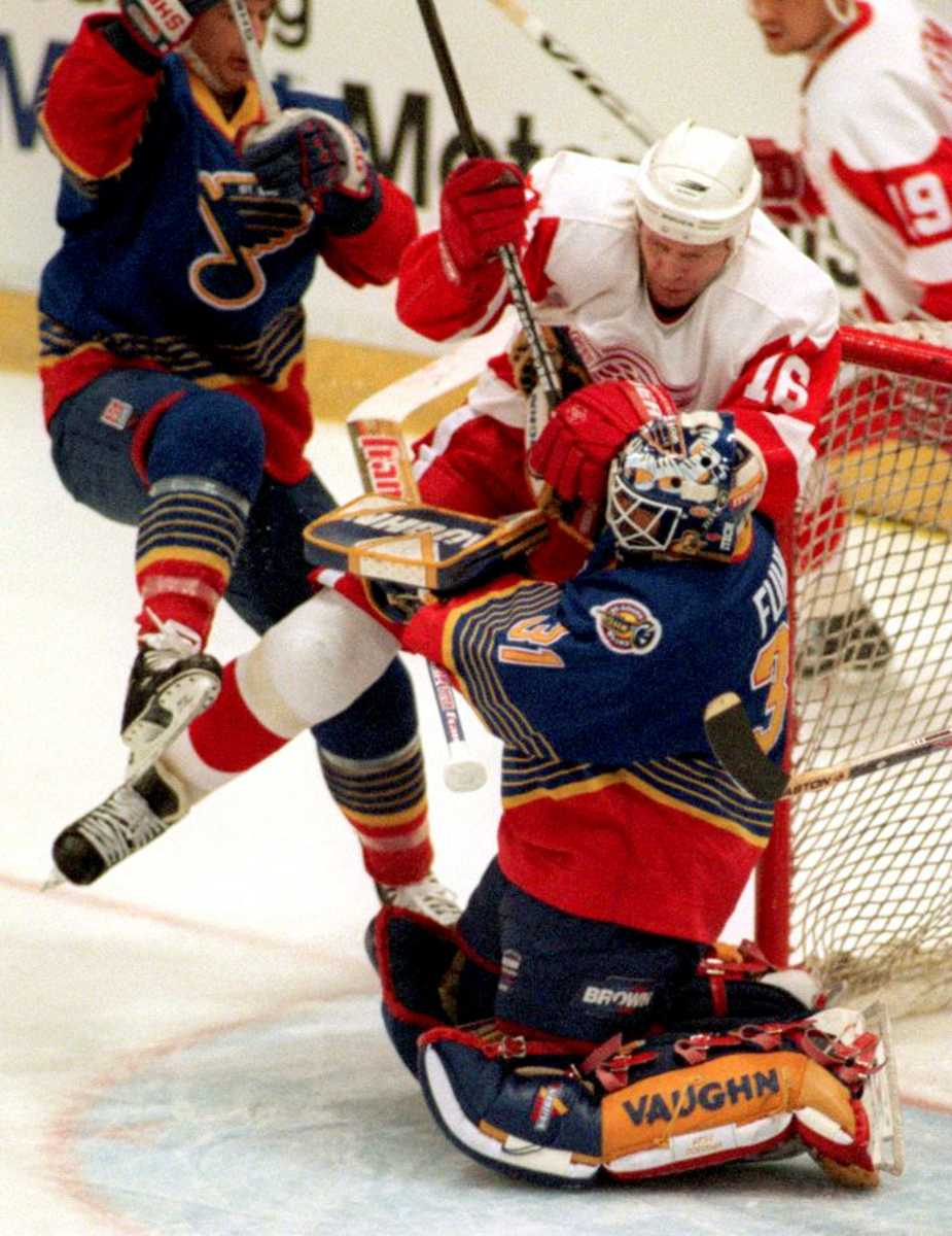 Blues goalie Grant Fuhr, #31, gets run into by Red Wing Vladimir Konstantino