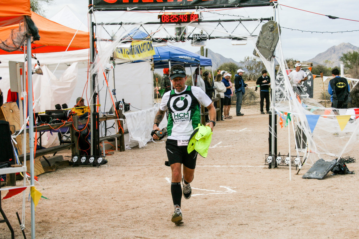 HCM, a jersey-sponsor nonprofit for which Agnew (at the start-finish line of the Javelina 100)raised money, parted ways with the runner in 2012, around the time he moved to Utah.