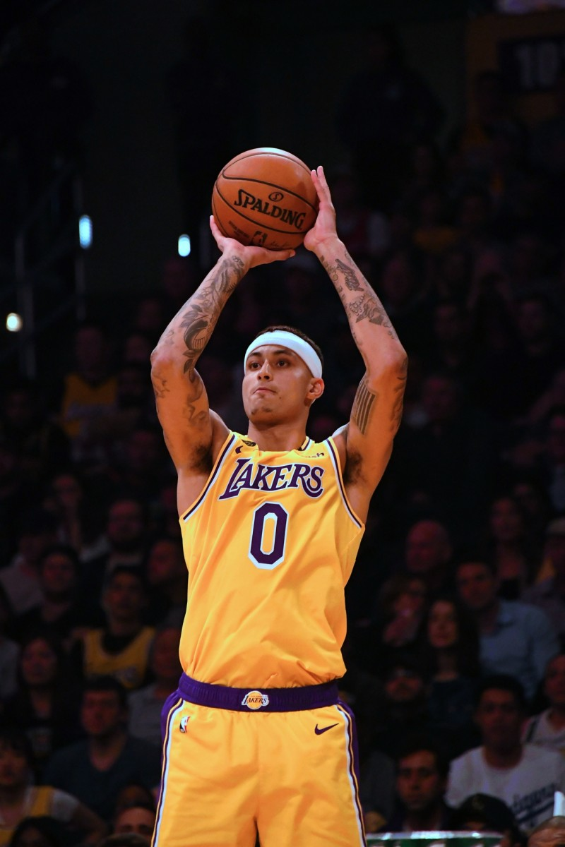 Mar 3, 2020; Los Angeles, California, USA; Los Angeles Lakers forward Kyle Kuzma (0) shoots the ball in the second half against the Philadelphia 76ers at Staples Center. Mandatory Credit: Richard Mackson-USA TODAY Sports