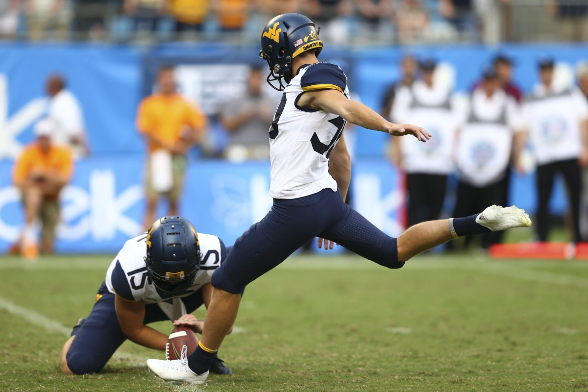 West Virginia Mountaineers place kicker Evan Staley (30) attempts a field goal in the second half against the Tennessee Volunteers at Bank of America Stadium.