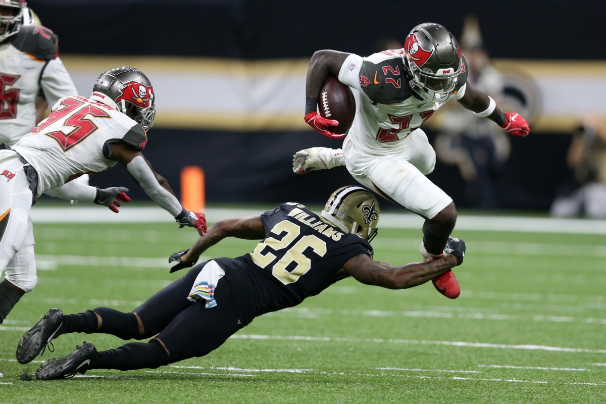 Oct 6, 2019; New Orleans, LA, USA; Tampa Bay Buccaneers running back Ronald Jones (27) is tackled by New Orleans Saints cornerback P.J. Williams (26) in the second half at the Mercedes-Benz Superdome. Mandatory Credit: Chuck Cook-USA TODAY Sports