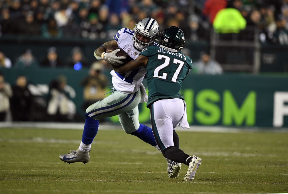Dec 22, 2019; Philadelphia, Pennsylvania, USA; Dallas Cowboys running back Ezekiel Elliott (21) is tackled by Philadelphia Eagles strong safety Malcolm Jenkins (27) during the fourth quarter at Lincoln Financial Field. Mandatory Credit: James Lang-USA TODAY Sports