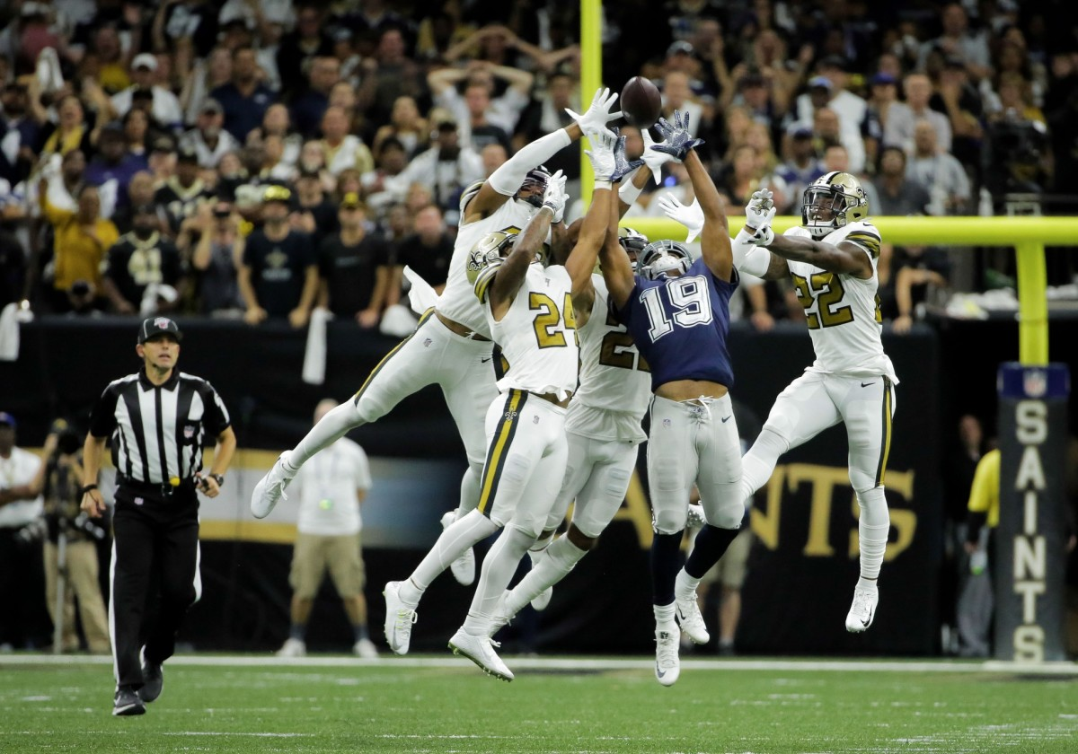 Sep 29, 2019; New Orleans, LA, USA; New Orleans Saints secondary Marcus Williams and Vonn Bell and Marshon Lattimore and Chauncey Gardner-Johnson break up a pass to Dallas Cowboys wide receiver Amari Cooper (19) during the fourth quarter at the Mercedes-Benz Superdome. Mandatory Credit: Derick E. Hingle-USA TODAY Sports