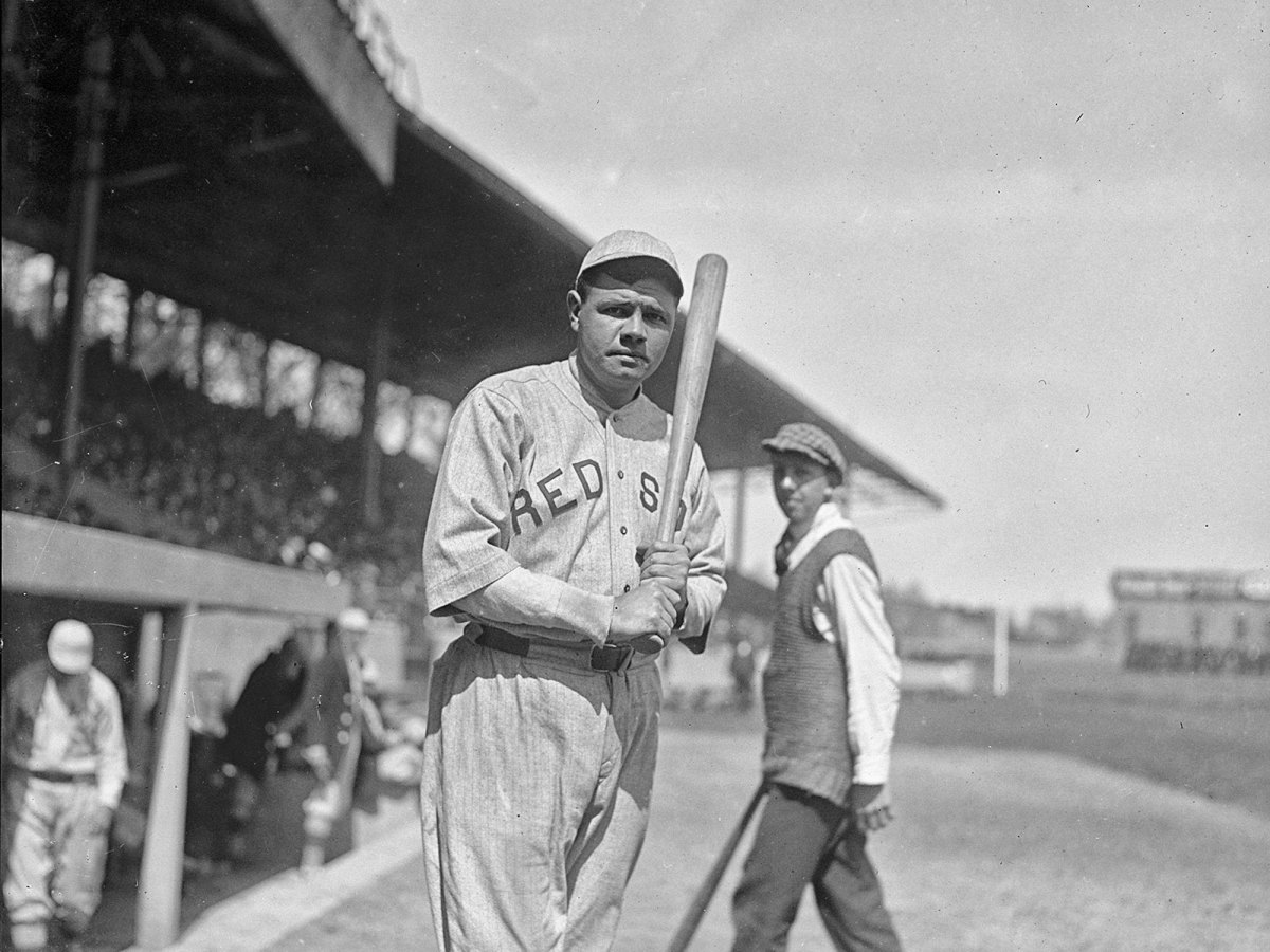 Red Sox hitter Babe Ruth holds a bat.