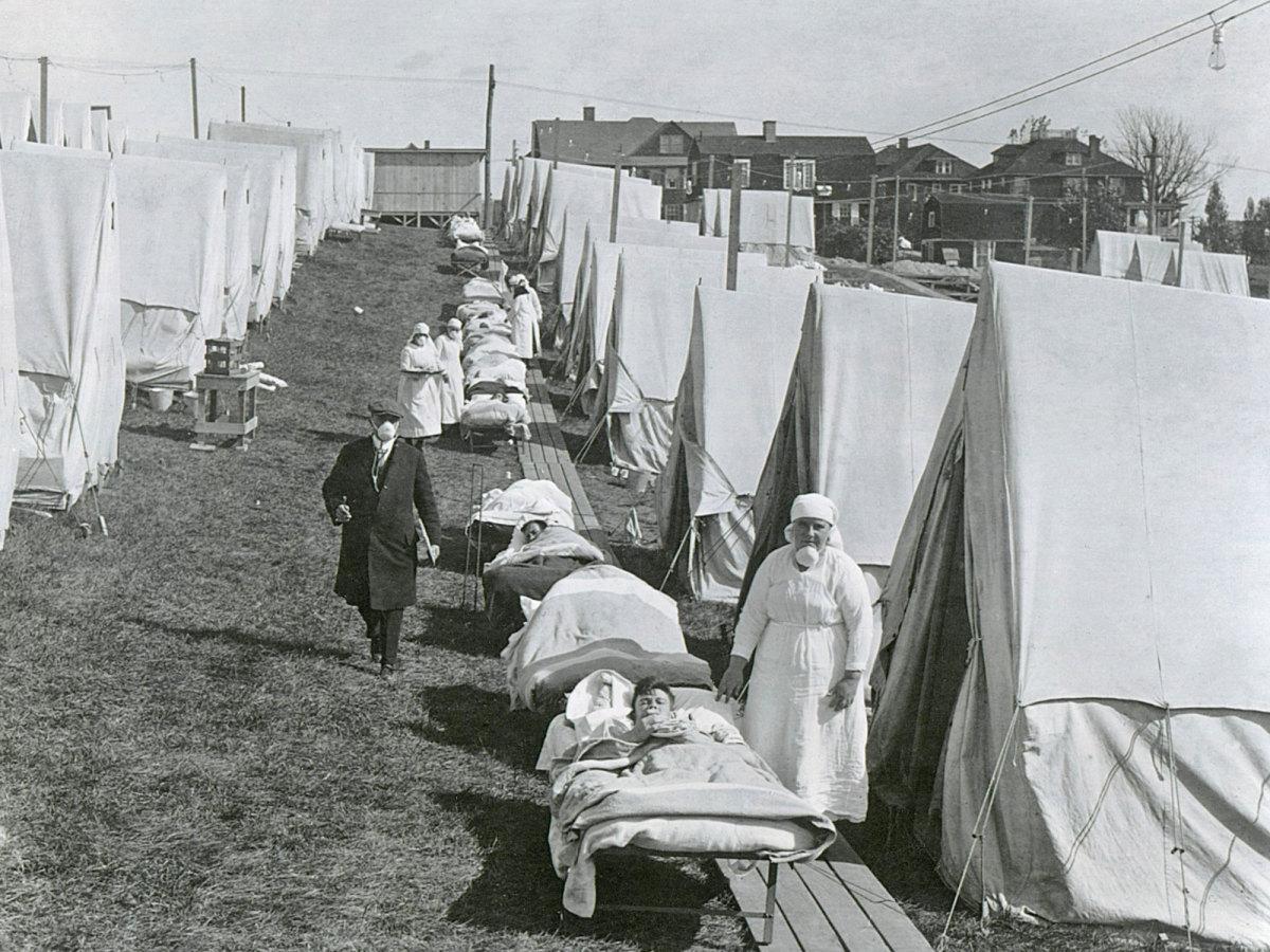 A line of medical tents treat flu patients.
