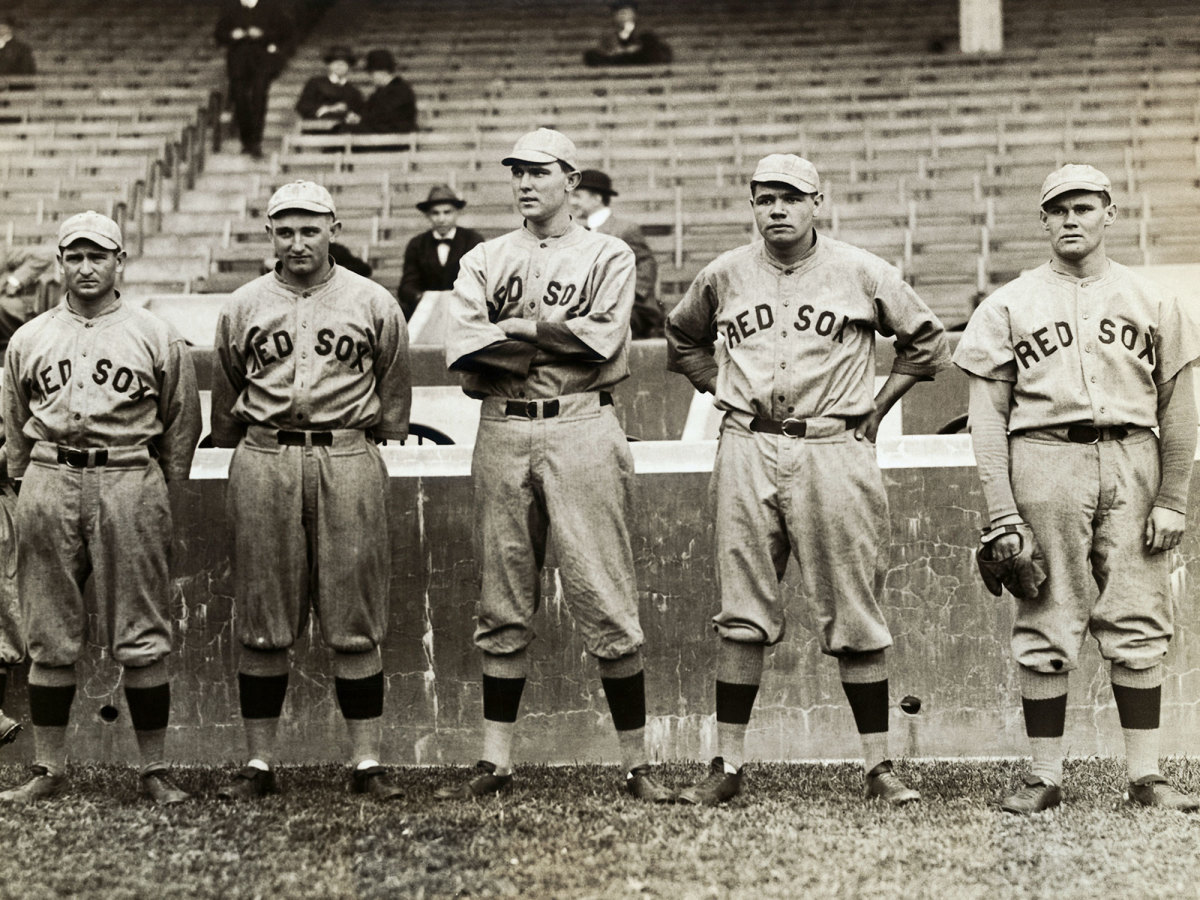 Members of the Red Sox, including Babe Ruth (second from right), stand together.