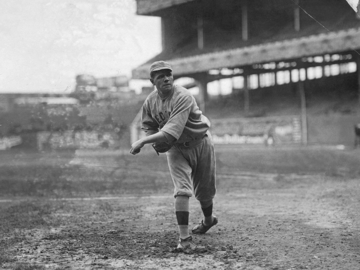Babe Ruth throwing on the field