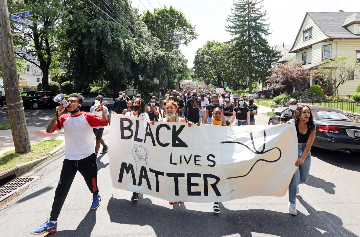 Black Lives Matter activists march in honor of Kamal Flowers and victims of police brutality June 12, 2020 in Mount Vernon. The group marched to New Rochelle, where 24-year-old Kamal Flowers was shot and killed by New Rochelle police. Black Lives Matter Protest