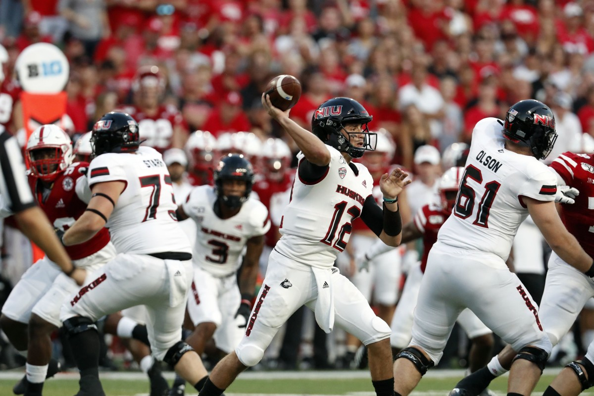 Northern Illinois Huskies quarterback Ross Bowers (12) throws against the Nebraska Cornhuskers in the first half of a 2019 game at Memorial Stadium in Lincoln, Nebraska.