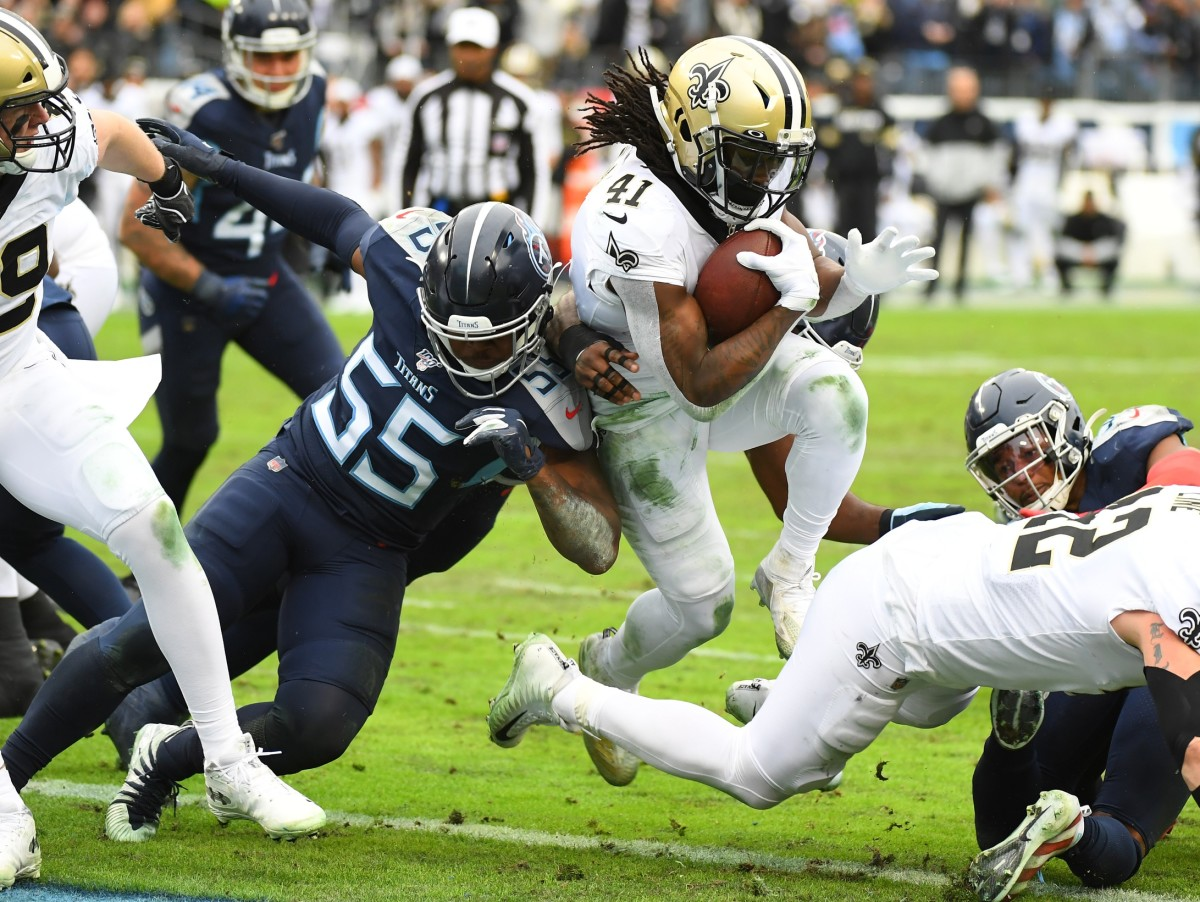 Dec 22, 2019; Nashville, Tennessee, USA; New Orleans Saints running back Alvin Kamara (41) scores as he is hit by Tennessee Titans inside linebacker Jayon Brown (55) during the second half at Nissan Stadium. Mandatory Credit: Christopher Hanewinckel-USA TODAY Sports