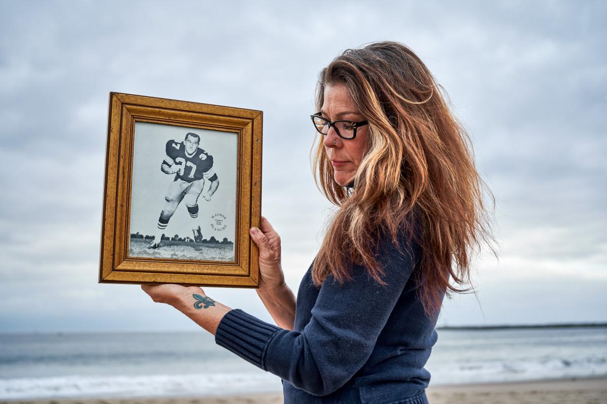 Linda Lee Stonebreaker holding a portrait of her father