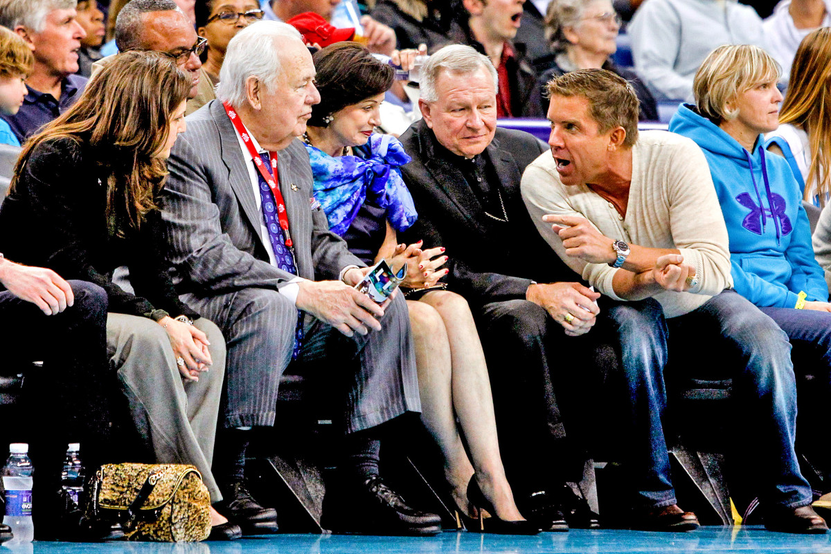 Tom Benson (above, left), the late Saints and Pelicans owner, willed the teams to Gayle; the archbishop regularly joined them at games.