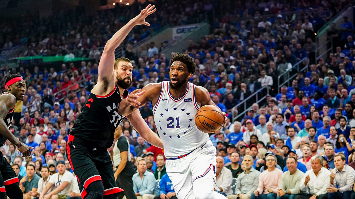 Joel Embiid drives against the Raptors