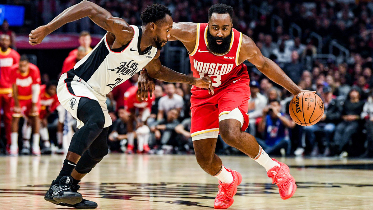 James Harden drives to the hoop against Patrick Beverley