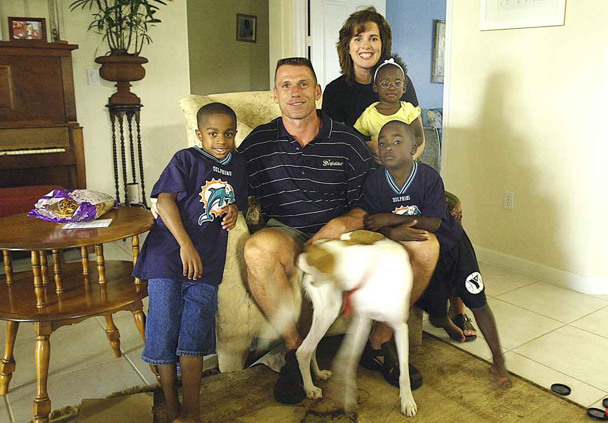 Spielman and his wife, Michele, with three of their adopted children.