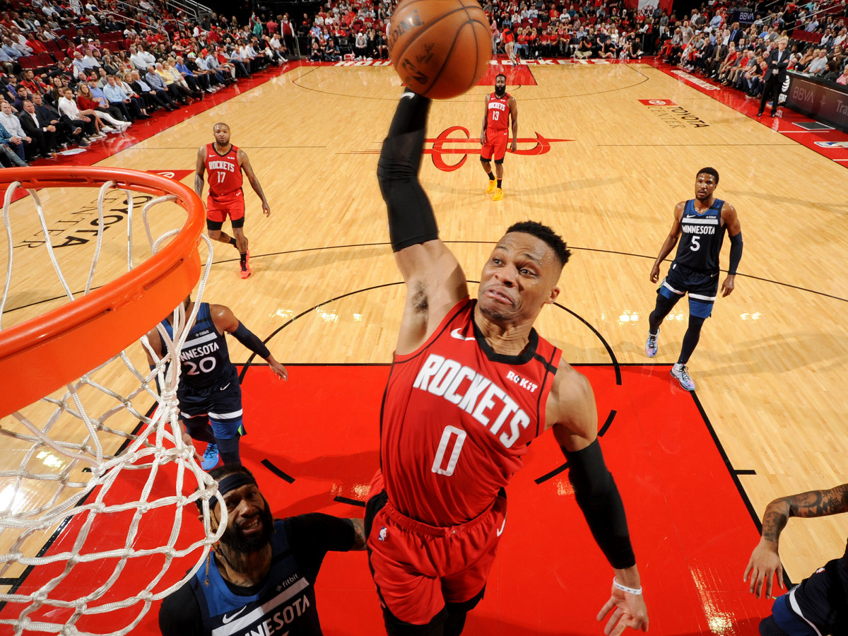 HOUSTON, TX - MARCH 10: Russell Westbrook #0 of the Houston Rockets dunks the ball against the Minnesota Timberwolves on March 10, 2020 at the Toyota Center in Houston, Texas.