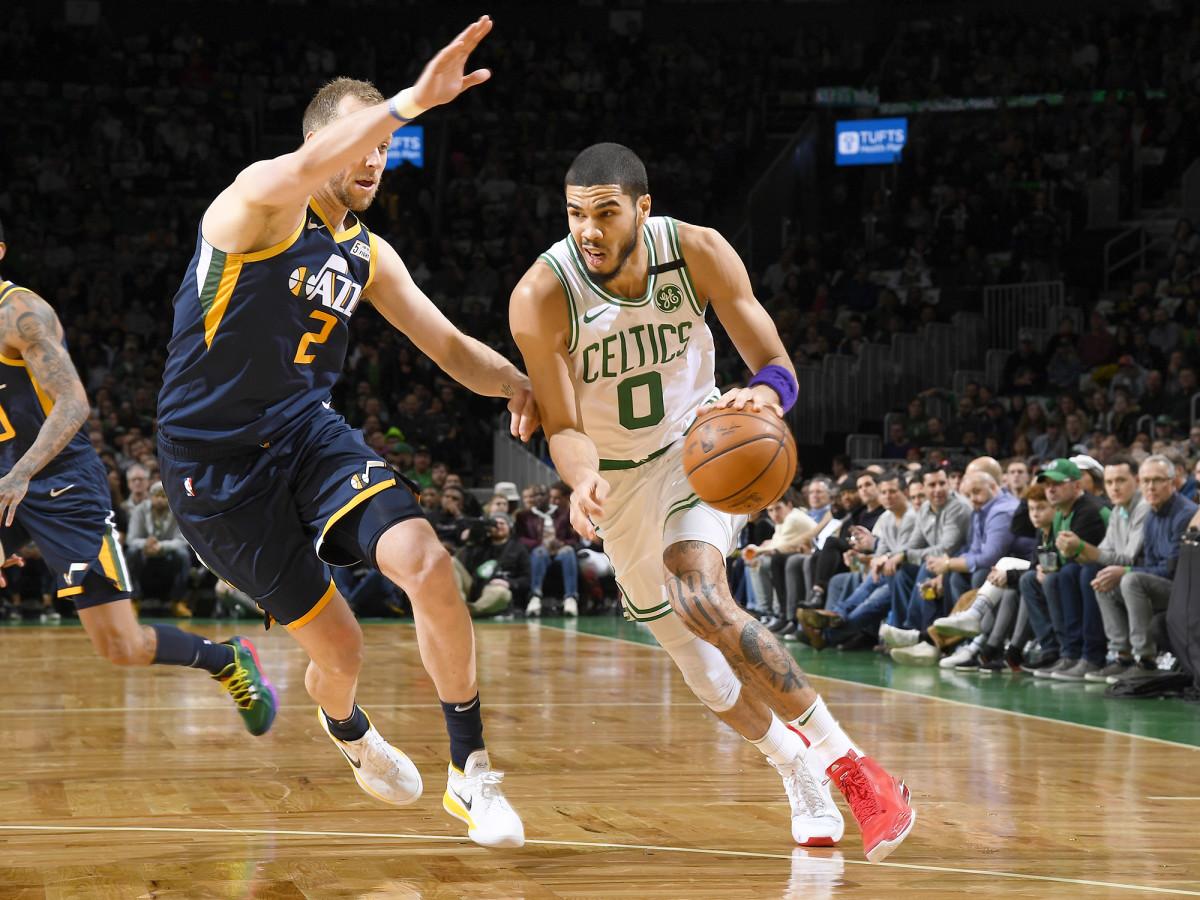 BOSTON, MA - MARCH 6:  Jayson Tatum #0 of the Boston Celtics handles the ball against the Utah Jazz on March 6, 2020 at the TD Garden in Boston, Massachusetts.