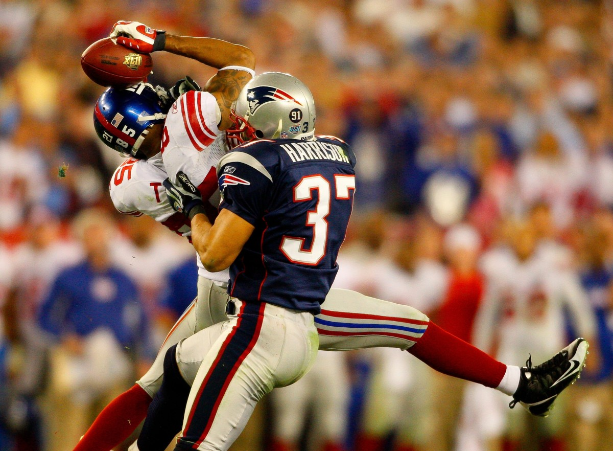 New York Giants receiver David Tyree catches a pass while in the clutches of New England Patriots safety Rodney Harrison during the fourth quarter of the Super Bowl XLII football game in Glendale, Ariz. on Feb. 3, 2008. 20587