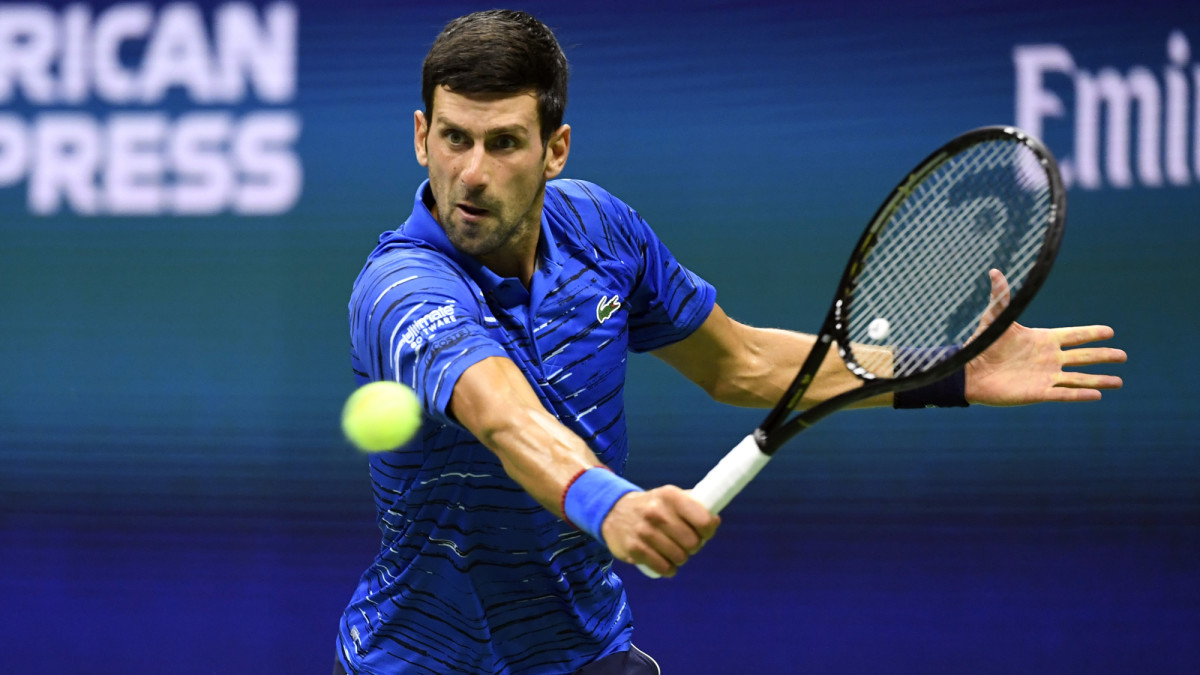 Novak Djokovic of Serbia hits to Stan Wawrinka of Switzerland in a fourth round match on day seven of the 2019 US Open tennis tournament at USTA Billie Jean King National Tennis Center.