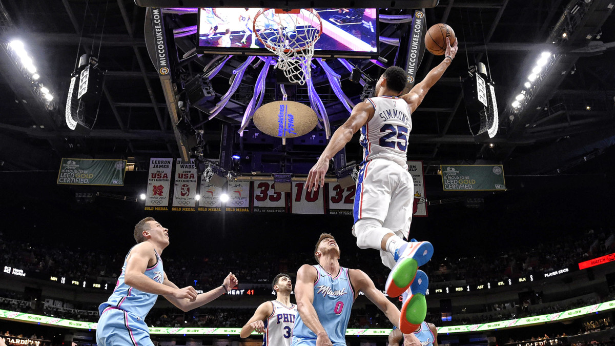 Ben Simmons soars for a dunk
