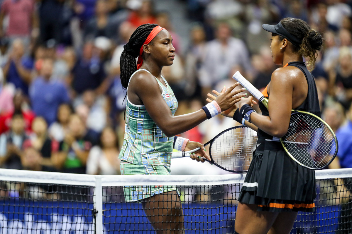 Naomi Osaka (right) and an end-of-her run Coco Gauff head in for a shake and a hug following a fourth-round U.S. Open match last August.