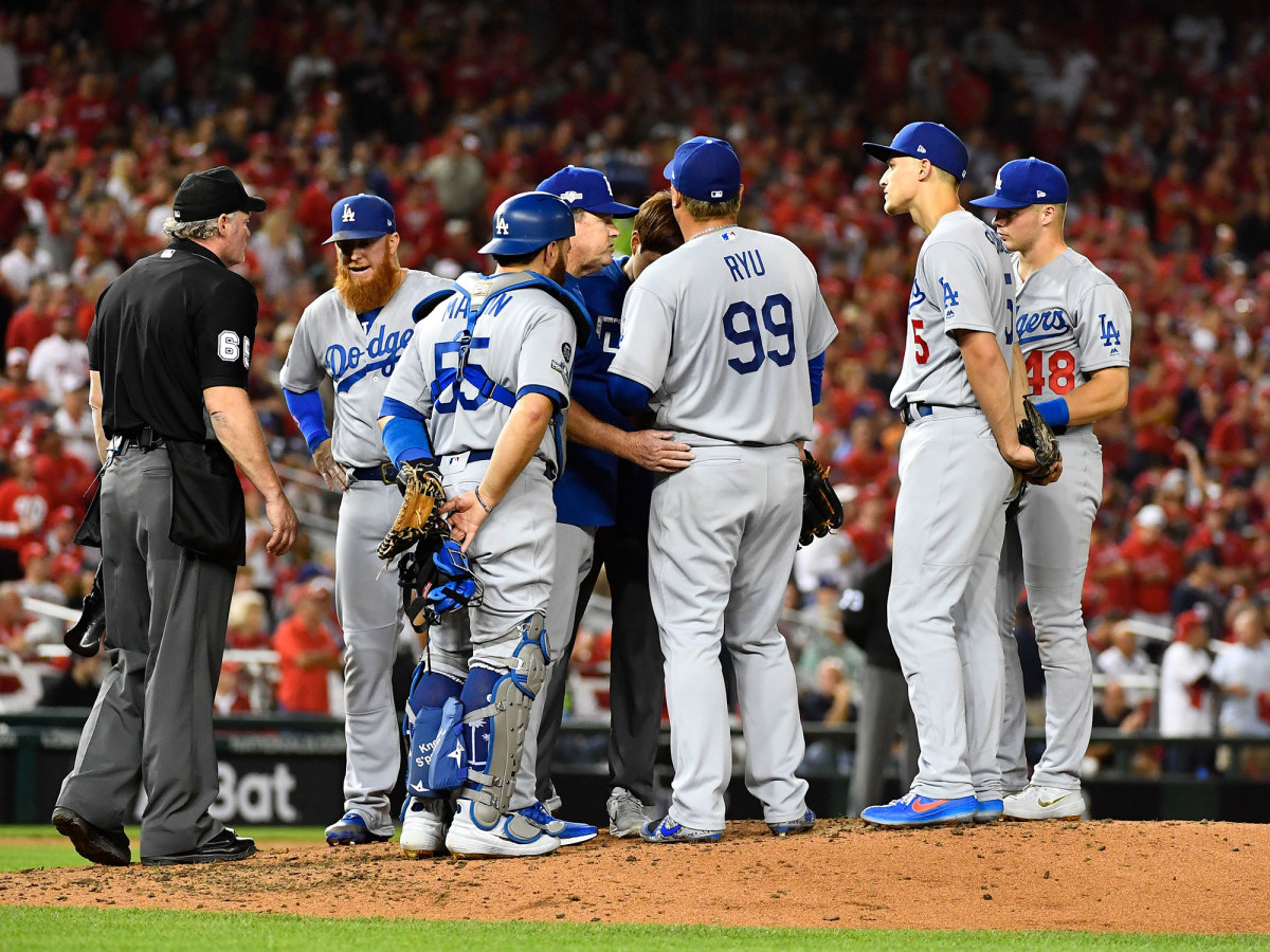 L.A. Dodgers players hang around the mound