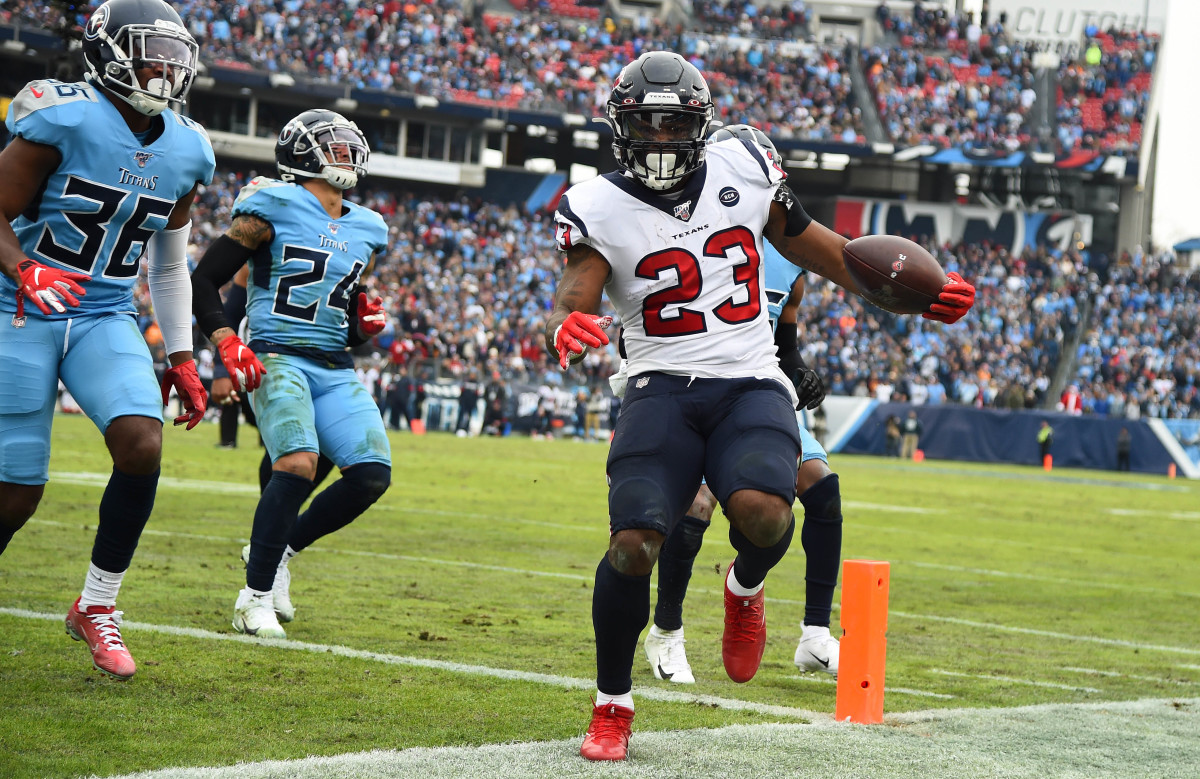 Texans running back Carlos Hyde (23) passes the pylon for a touchdown against the Titans during the 2019 season. With 1,070 yards on the ground, he became the most recent Houston player to rush for at least 1,000 yards in a season.
