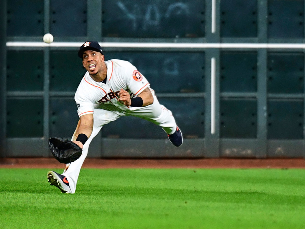 Michael Brantley diving for a ball