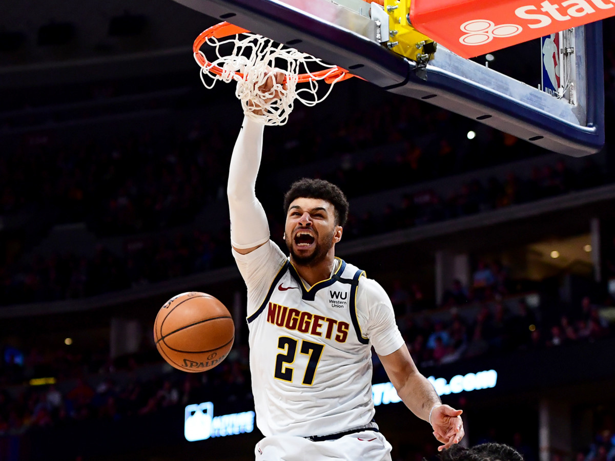 March 9, 2020; Denver, Colorado, USA; Denver Nuggets security guard Jamal Murray (27) ends a basket over Milwaukee Bucks striker D.J. Wilson (5) in the third quarter at the Pepsi Center.