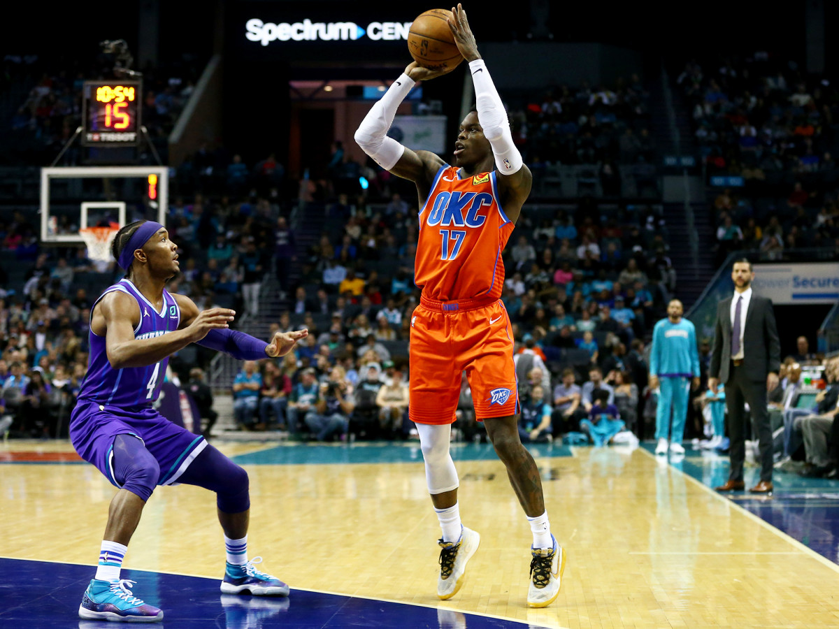 December 27, 2019; Charlotte, North Carolina, USA; Dennis Schroder (17), Oklahoma City's Thunder Guard, shoots the ball in the first half at the Spectrum Center against Devonte 'Graham (4) of Charlotte Hornets.