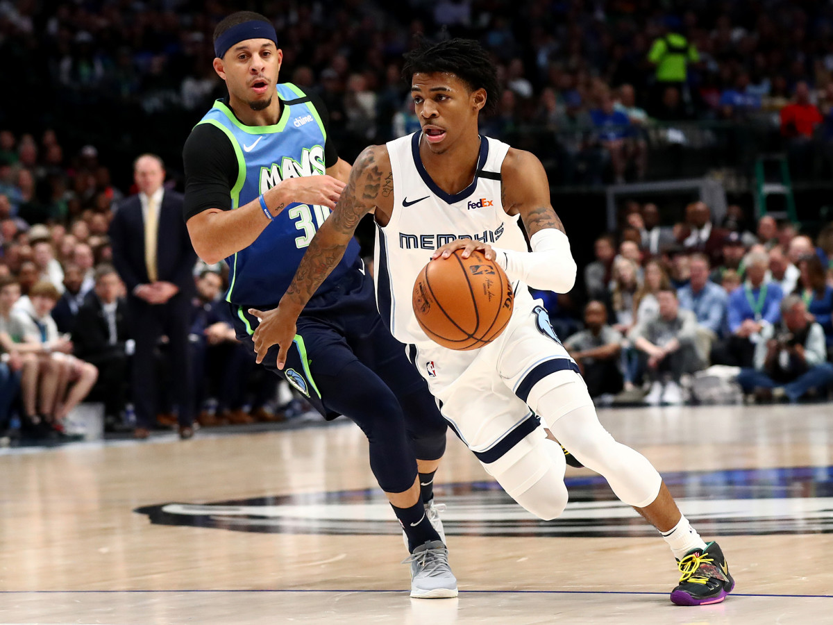 March 6, 2020; Dallas, Texas, USA; The security guard from Memphis Grizzlies, Ja Morant (12), drives in the second quarter at the American Airlines Center against the security guard from Dallas Mavericks, Seth Curry (30).