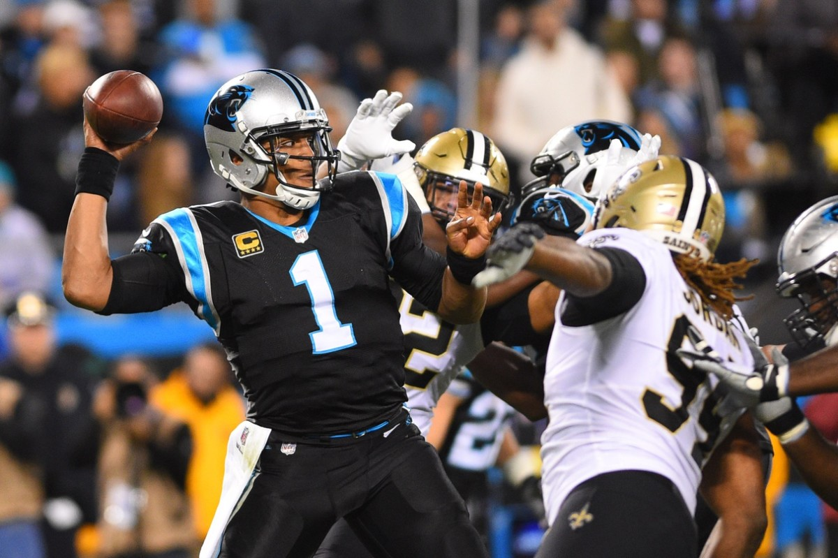 Dec 17, 2018; Charlotte, NC, USA; Carolina Panthers quarterback Cam Newton (1) looks to pass as New Orleans Saints defensive end Cameron Jordan (94) defends in the second quarter at Bank of America Stadium. Mandatory Credit: Bob Donnan-USA TODAY Sports