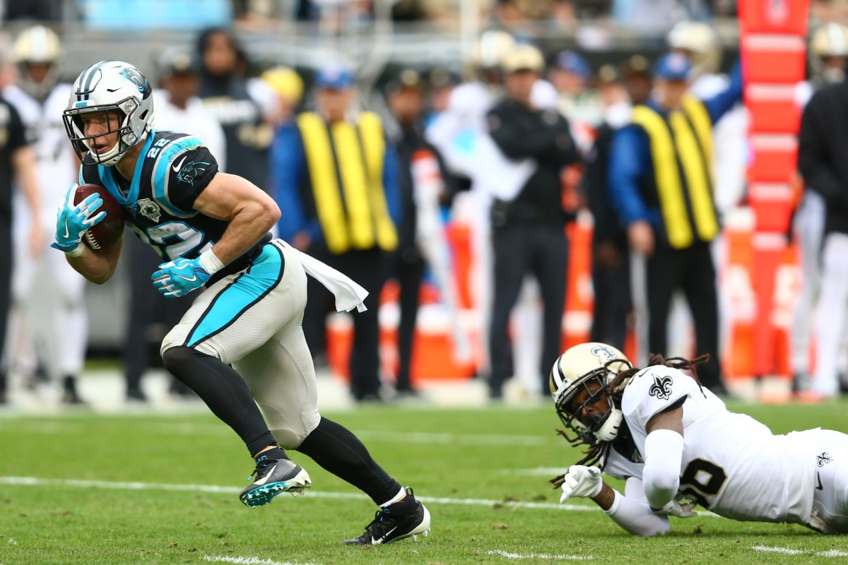 Dec 29, 2019; Charlotte, North Carolina, USA; Carolina Panthers running back Christian McCaffrey (22) runs after a reception during the second quarter against the New Orleans Saints at Bank of America Stadium. Mandatory Credit: Jeremy Brevard-USA TODAY Sports