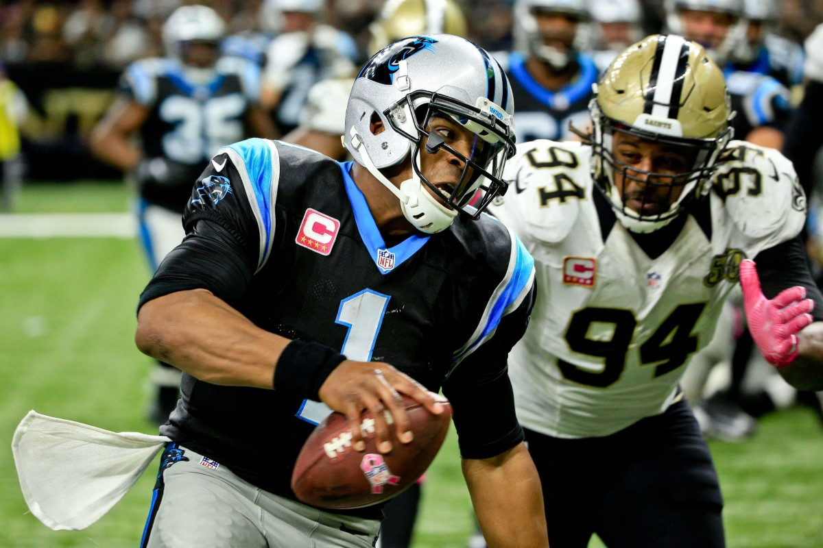 Oct 16, 2016; New Orleans, LA, USA; Carolina Panthers quarterback Cam Newton (1) runs with the ball past New Orleans Saints defensive end Cameron Jordan (94) to score a touchdown during the fourth quarter at the Mercedes-Benz Superdome. The Saints won 41-38. Mandatory Credit: Derick E. Hingle-USA TODAY Sports