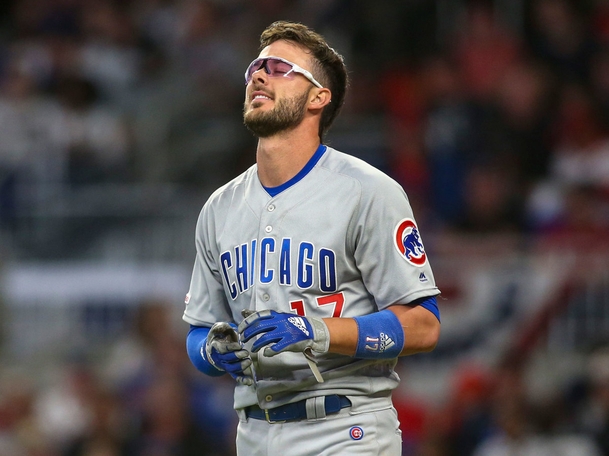 Kris Bryant grimaces after striking out