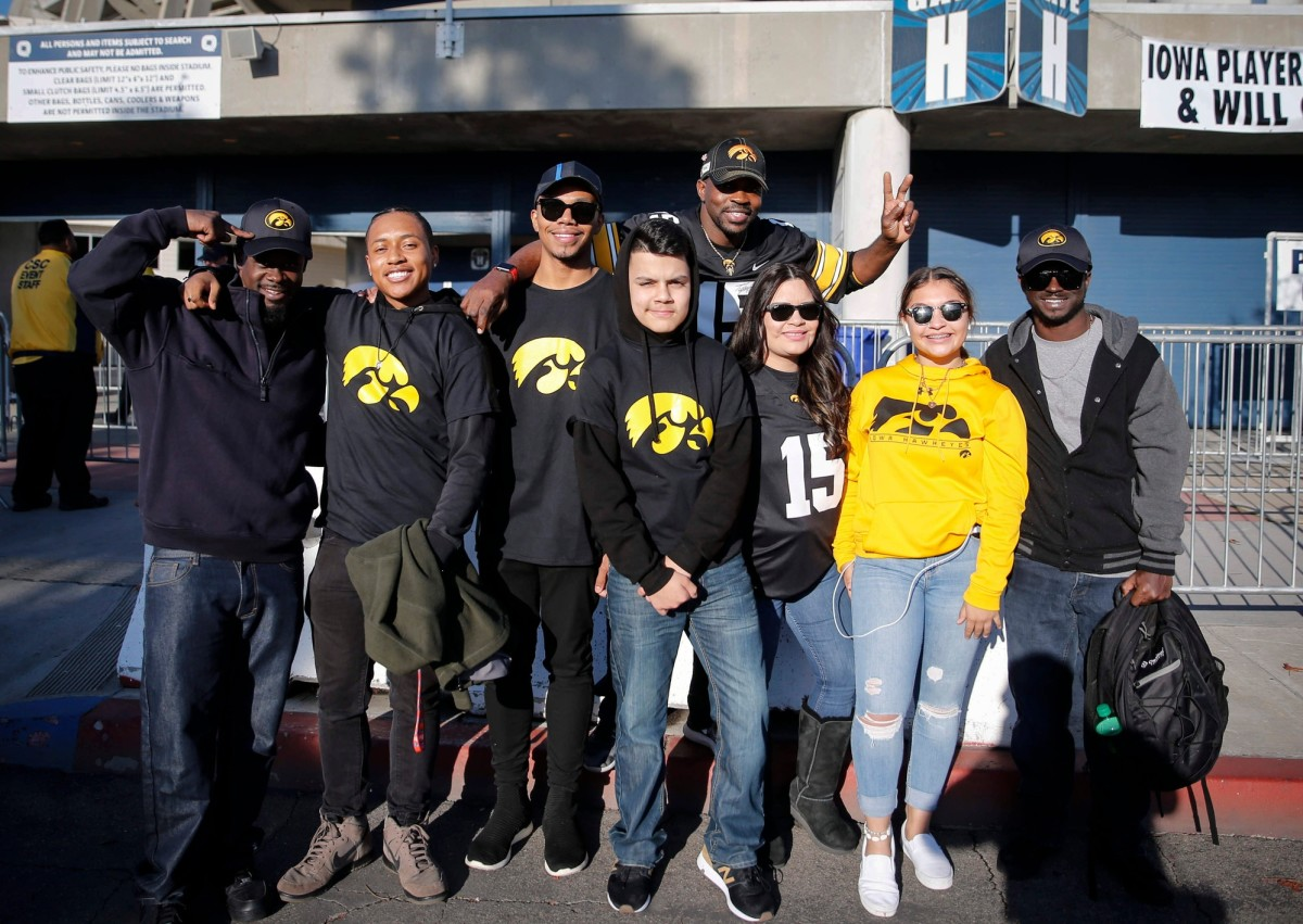 Members of Tyler Goodson's family pose for a photo before last December's Holiday Bowl. (Bryon Houlgrave/Des Moines Register-Imagn Content Services)