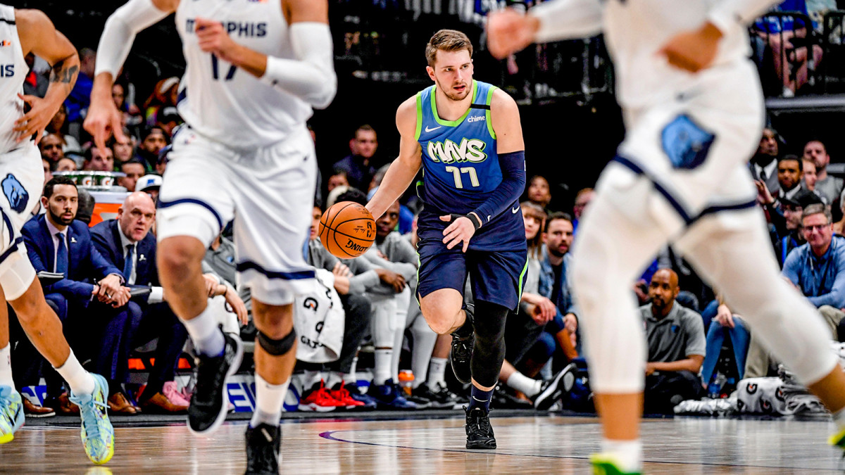 Luka Doncic brings the ball up the court against the Grizzlies