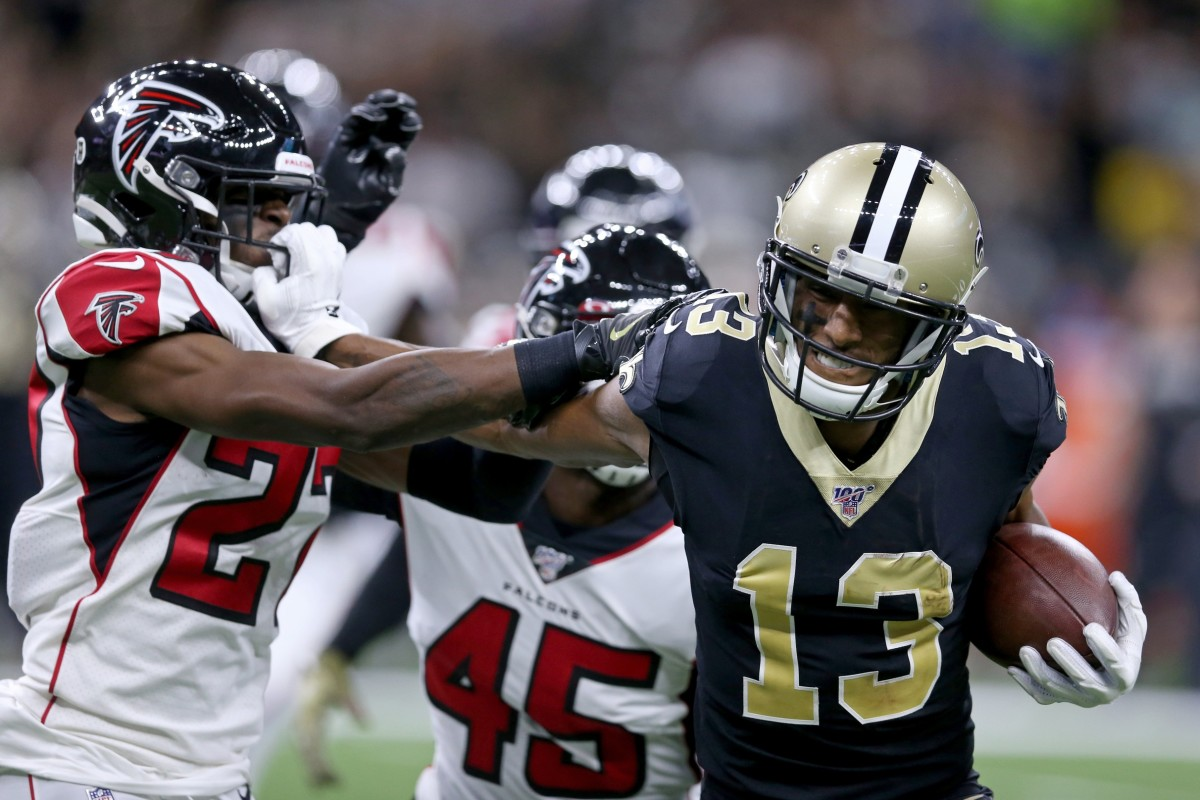 Nov 10, 2019; New Orleans, LA, USA; New Orleans Saints wide receiver Michael Thomas (13) pushes Atlanta Falcons strong safety Damontae Kazee (27) away by his facemark in the second quarter at the Mercedes-Benz Superdome. Thomas was called for a facemark penalty. Mandatory Credit: Chuck Cook-USA TODAY Sports