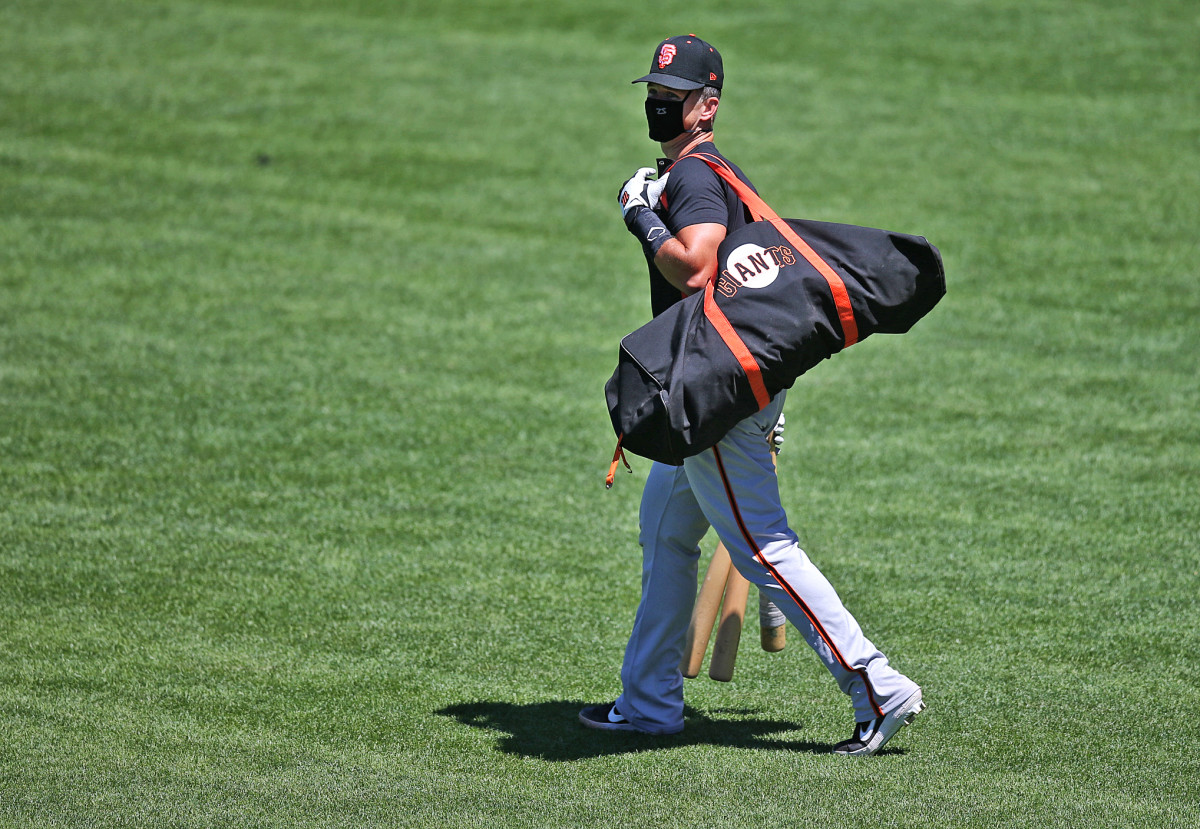 Buster Posey's Giants were among the teams that had to cancel practice this week because of testing delays.