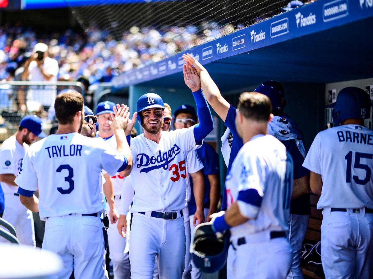 Cody Bellinger high-fives Dodgers teammates