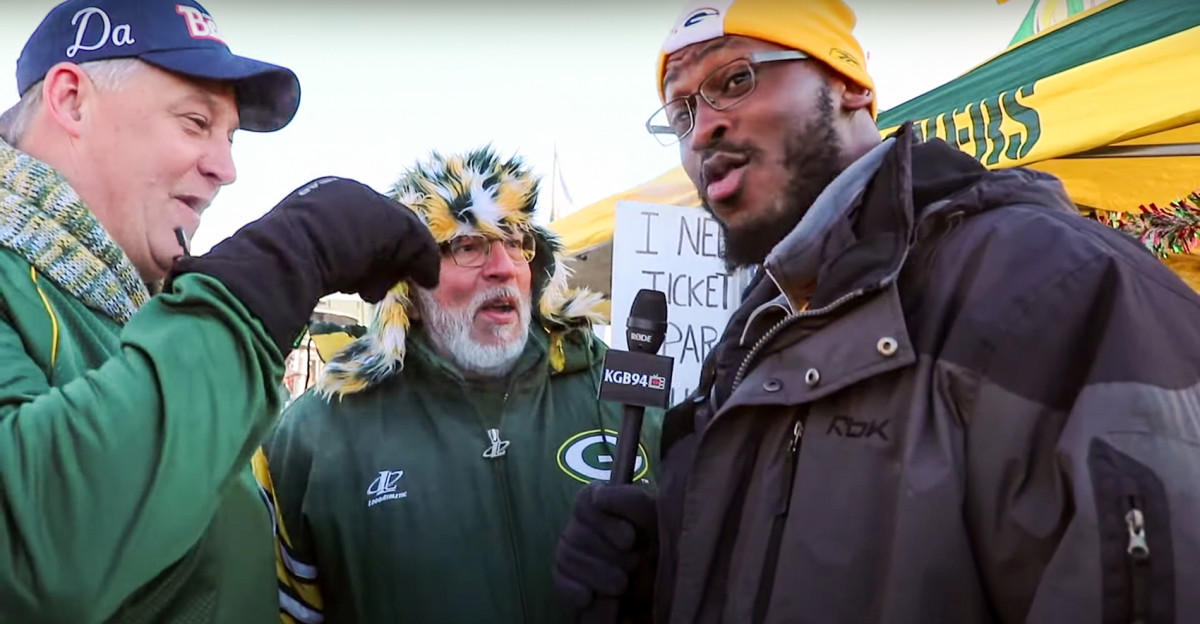 Kabeer Gbaja-Biamila interacts with fans at a Lambeau Field tailgate for a YouTube video