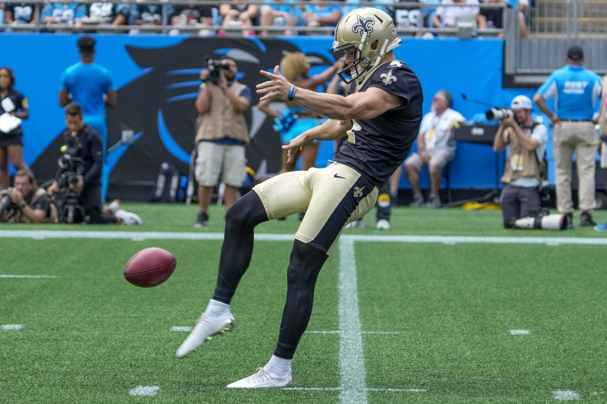 New Orleans Saints punter Blake Gillikin (4) punts during the first quarter against the Carolina Panthers. Mandatory Credit: Jim Dedmon-USA TODAY