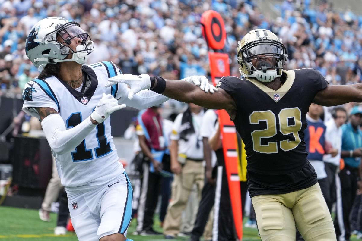 Carolina receiver Robby Anderson (11) and New Orleans Saints cornerback Paulson Adebo (29) vie for a reception. Mandatory Credit: Jim Dedmon-USA TODAY Sports