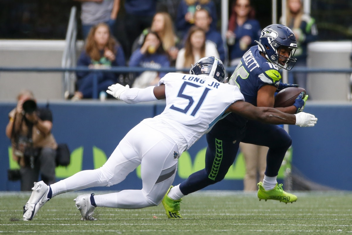 Sep 19, 2021; Seattle, Washington, USA; Seattle Seahawks wide receiver Tyler Lockett (16) runs for yards after the catch against the Tennessee Titans during the fourth quarter at Lumen Field. Mandatory Credit: Joe Nicholson-USA TODAY Sports