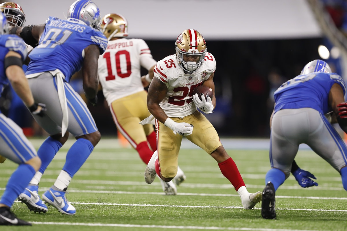 Sep 12, 2021; Detroit, Michigan, USA; San Francisco 49ers running back Elijah Mitchell (25) runs with the ball against the Detroit Lions during the fourth quarter at Ford Field. Mandatory Credit: Raj Mehta-USA TODAY Sports