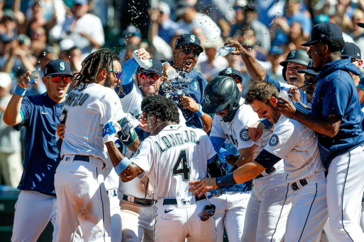 The Mariners celebrate Shed Long Jr.'s walk-off home run in the bottom of the 10th inning, which gave them a 6–2 win over the Rays at T-Mobile Park in Seattle on June 20, 2021.