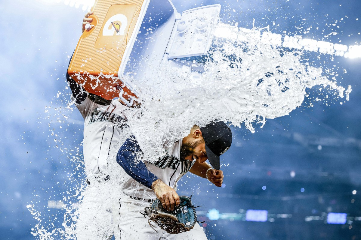 Abraham Toro gets dosed with a cooler of water after hitting a game-winning grand slam off Astros reliever Kendall Graveman on Aug. 31. The Mariners traded Graveman for Toro just over a month earlier.