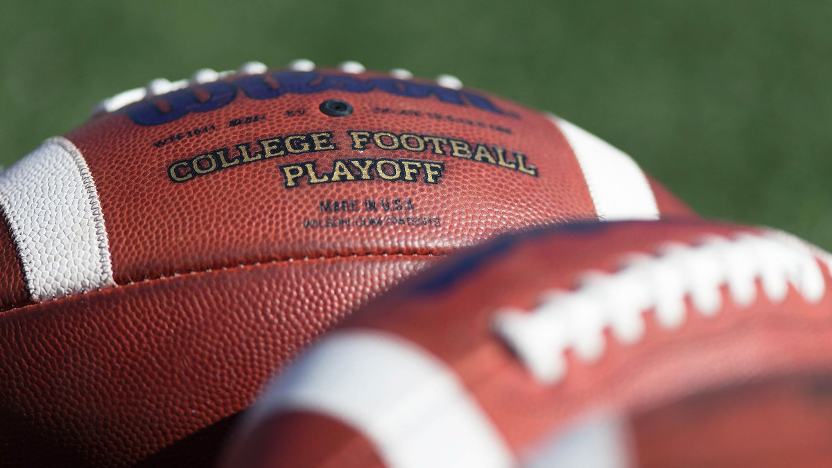 'College Football Playoff' is printed on a football