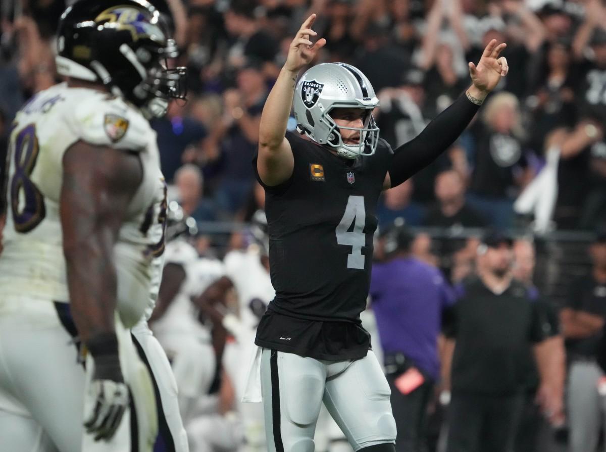 Las Vegas Raiders quarterback Derek Carr (4) celebrates the touchdown scored by running back Josh Jacobs (28) against the Baltimore Ravens during the second half at Allegiant Stadium.